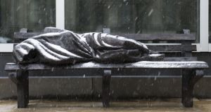 Snow falls on Homeless Jesus in Toronto. Photograph: Carlos Osorio/Toronto Star via Getty Images