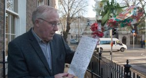 Lord Mayor of Dublin Christy Burke  looks at flowers and messages  left at the scene where a homless man died on Molesworth St in Dublin this week. Photograph:  Collins