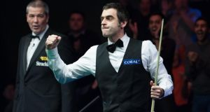 Ronnie O'Sullivan celebrates a maximum break of 147 in the final frame of his 6-0 victory over Matthew Selt during the 2014 Coral UK Championship at the Barbican Centre, York. Photograph: Tim Goode/PA Wire
