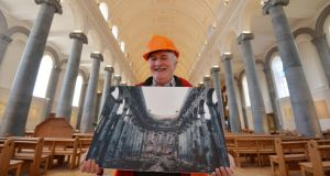 Tiernan Dolan, who created a photographic record of the rebuild during the five-year project. Photograph: Alan Betson / The Irish Times Tiernan Dolan, who created a photographic record of the rebuild of St Mel's Cathedral in Longford