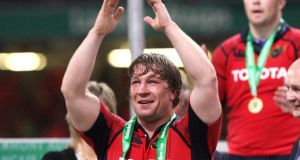 Munster's  Jerry Flannery gets his hands on a Heineken Cup medal in 2006. Photograph: Billy Stickland/Inpho
