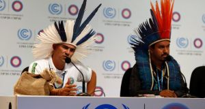 Marcos Avilques and Marcio Kokoj of the Co-ordination of the Indigenous Organisations of the Brazilian Amazon address a news conference as part of the UN climate change conference in Lima. Photograph: Mariana Bazo/Reuters