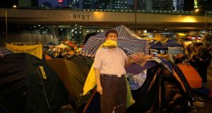 A life-size cut-out of China's president Xi Jinping among tents and shelters of pro-democracy students at the Occupy Hong Kong camp in the Admiralty district this week. Photograph: How Hwee Young/EPA