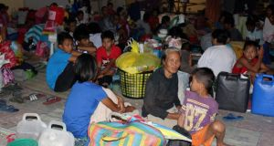 Residents take shelter in Pope Francis complex in Tacloban city, central Philippines after fleeing their houses due to Typhoon Hagupit. Photograph: Rowel Montes/Reuters
