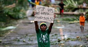 A  typhoon victim pleads for help in the town of Taft, Samar island. Photorgaph:  EPA/Francis R Malasig