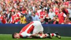 Mathieu Debuchy of Arsenal was injured in the first half during the Barclays Premier League match between Arsenal and Manchester City at Emirates Stadium on September 13, 2014 in London, England. Photograph: Shaun Botterill/Getty Images