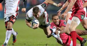 Ulster's Craig Gilroy is tackled by the Scarlets' Michael Tagicakibau during Saturday's clash. Photograph: INPHO/Presseye/Darren Kidd
