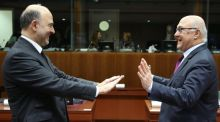European commissioner for economic and financial affairs, taxation and customs Pierre Moscovici (left) and French finance minister Michel Sapin at the start of the Ecofin meeting at the European Council headquarters in Brussels. Photograph: Julien Warnand/EPA
