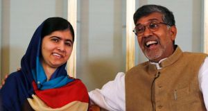 Nobel Peace Prize laureates Kailash Satyarthi (R) and Malala Yousafzai during a news conference in Oslo on Tuesday.  Photograph: Suzanne Plunkett/Reuters