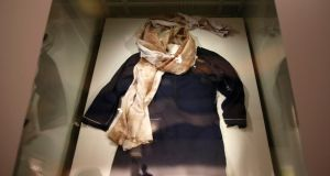 The blood soaked school uniform belonging to Nobel Laureate Malala Yousafzai is displayed at the Nobel Peace Center in Oslo. Photograph: Suzanne Plunkett/Reuters.
