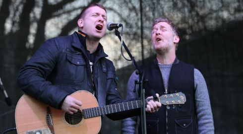 Damien Dempsey (left) and Glen Hansard perform at the Right2Water anti-water charges protest outside Leinster House. Photograph: Niall Carson/PA Wire