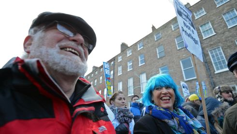 Wigging out: John Howe and Mary McGrath from Dun Laoghaire, Co Dublin, keep the smiles up during the water demonstration.  Photograph: Eric Luke/The Irish Times