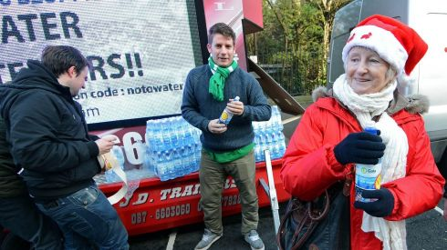 I'll have a drop to drink: free water for protesters.  Photograph: Eric Luke/The Irish Times
