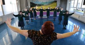 Shirley Higgins, conductor of St Mary's signing choir, and members of the choir rehearsing at the school in Cabra. Photograph: Alan Betson
