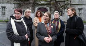 "NUIG has  ""unreservedly accepted"" the ruling of the Equality Tribunal which found  Dr Micheline Sheehy Skeffington (centre) had been discriminated against in her application for a senior lecturership in 2009. Photograph: Joe O'Shaughnessy"