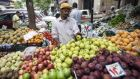 A fruit vendor  at a Cairo market. Government interventions aim to improve life for Egyptians. Photograph: Mahmoud Khaled/AFP/Getty Images