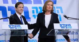 Yitzhak Herzog, leader of Israel's Labour Party, and former Israeli justice minister Tzipi Livni have formed a joint election ticket that could pose a serious challenge to prime minister Binyamin Netanyahu. Photograph: Reuters