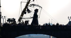 A cultural highlight: Tens of thousands people turned out to watch Royal de Luxe's Grandmother crossing Sarsfield Bridge in Limerick. Photograph:  Liam Burke/Press 22