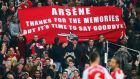 WEST BROMWICH, ENGLAND - NOVEMBER 29: (EDITORS NOTE: This is a retransmission of image #459708260 with an alternative crop) Arsenal fans hold up a banner for Arsene Wenger, manager of Arsenal during the Barclays Premier League match between West Bromwich Albion and Arsenal at The Hawthorns on November 29, 2014 in West Bromwich, England (Photo by Mark Thompson/Getty Images)