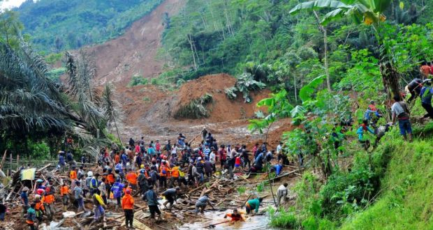 Indonesian rescuers search for victims after a landslide hit Jemblung village. Photograph: Himawan Listya Nugraha/EPA