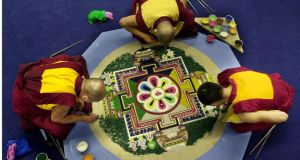 Tibetan Monks construct a sand Mandala of the Buddha of Compassion at the Chester Beatty Library. Photograph: The Irish Times
