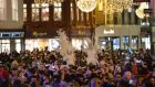 'The Christmas lights are twinkling and the cocktail glasses are clinking, but there are endless streams of people begging.' Photograph: Alan Betson / The Irish Times