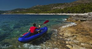 Go kayaking in the  Adriatic sea, near the island of Hvar in Croatia