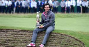 Northern Ireland's Rory McIlroy with the Claret Jug after winning the 2014 Open Championship at Royal Liverpool Golf Club, Hoylake.  Photo:  Owen Humphreys/PA