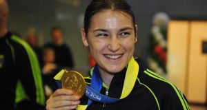 Katie Taylor pictured at Dublin Airport after arriving home from the world women's boxing championships in South Korea where she won her fifth gold medal. Photograph: Aidan Crawley