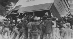 Rioters turn a burning lorry into a barricade in the Divis Flats area of Belfast in May 1981 as violence erupted following the death of Irish Republican Army hunger striker Bobby Sands. Photograph: Keystone/Getty Images