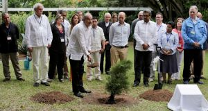 Colombian lead government negotiator Humberto de la Calle (c) plants a tree as part of the peace conversations between the Farc-EP and the Colombian government in Havana on December 16th, 2014. Photograph: Enrique De La Osa/Reuters