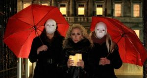 The Sex Workers Alliance  criticised the new Criminal Law (Sexual Offences) Bill at a candlelit vigil outside Leinster House.   Photograph: Nick Bradshaw/The Irish Times