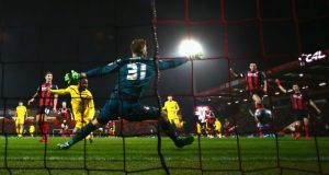 Raheem Sterling heads in Liverpool's opening goal in their 3-1 League Cup win over AFC Bournemouth