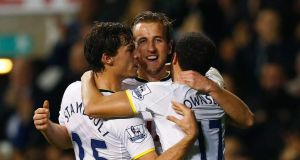 Tottenham Hotspur's Harry Kane (C) celebrates scoring a goal with Benjamin Stambouli (L) and Andros Townsend during their English League Cup quarter-final win over Newcastle United at White Hart Lane