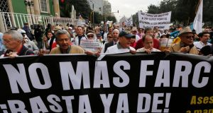 "People demonstrate against the Farc rebels in Bogota holding a banner that reads, ""No more Farc"". Photograph: John Vizcaino/Reuters"