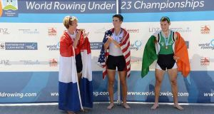 Franciscus Goutier of the Netherlands (silver), Andrew Campbell Jr of the United States (gold) and Ireland's Paul O'Donovan of Ireland (bronze) during the medal ceremony of the U-23 lightweight men's single sculls at the 2013 World Rowing U- 23 Championships in Linz-Ottensheim, Austria.