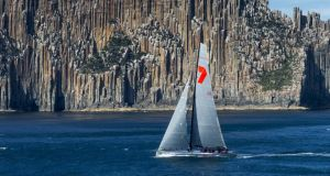 Wild Oats XI, the seven-time line honours winner of the Rolex Sydney Hobart race passes the 'Organ Pipes' cliff face off the New South Wales coast. Photograph: Carlo Borlenghi/Rolex