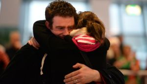 Home for Christmas: Joseph Callaghan is welcomed home from Canada by his wife Elaine  at Dublin Airport last year. Photograph: Dara Mac Dónaill / The Irish Times