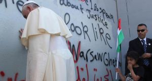 Frontier: the pope at the Israel-West Bank wall. photograph: Mheisen Amareen/Reuters