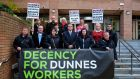 Members of the Mandate trade union and Dunnes Stores workers pictured outside the Labour Court in October 2014. They are seeking more secure working hours and earmings for all workers in the company. Photograph: Aidan Crawley/The Irish Times