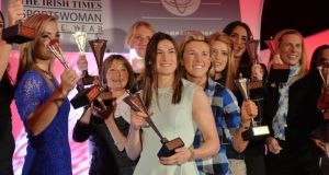 Joanna Morgan, winner of the Lifetime Achievement Award and Katie Taylor winner of the Sportswoman of the Year 2014 surrounded by the monthly winners on stage at the 10th Annual The Irish Times/Irish Sports Council Sportswoman of the Year awards at The Shelbourne Hotel. Photograph: Alan Betson/The Irish Times