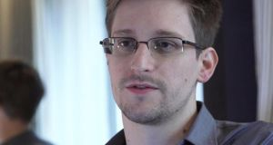 It's now over a year since Edward Snowden (above) went public with evidence of mass surveillance and extensive abuses by the NSA, GCHQ and other intelligence agencies. 'The Data Protection Commissioner has had her funding doubled, while the Minister of State for Data Protection, Dara Murphy, has called for the US government to obey Irish laws in seeking to access information held by Microsoft in its Irish data centre.' Photograph: AP Photo/The Guardian
