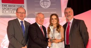 Hockey player Sarah Greene picking up the Irish Times Sportswoman of the Year monthly award for February from Irish Times Editor Kevin O'Sullivan (left), Minister of State at the Department of  Sport Michael Ring, Kieran Mulvey chairman of the Irish Sports Council. Photograph: Inpho