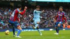 David Silva scores his and Manchester City's second goal  in the  Premier League match against Crystal Palace at Etihad Stadium. Photograph: Alex Livesey/Getty Images