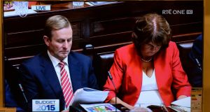 Taoiseach Enda Kenny and Tánaiste Joan Burton during the announcement of Budget 2015: Three opinion polls to be published tomorrow show Fine Gael and Labour struggling for support. Photograph: Dara Mac Dónaill/The Irish Times.