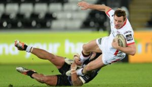 Ulster's Tommy Bowe is tackled by Ospreys' Josh Matavesi at Liberty Stadium. Photograph: Ian Cook / Inpho