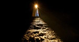 A file image from last year showing the sun shining along the passage floor into the inner chamber at Newgrange during the Winter Solstice. The passage tomb in Co Meath was built over 5,000 years ago. Photograph: Alan Betson/The Irish Times