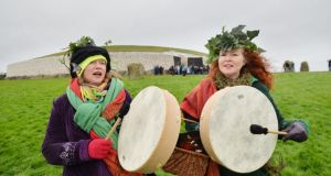 Sherrie Scott from Co Donegal and Karen Ward from Smithfield, Dublin, visitors to the Newgrange Monument on the morning of the Winter Solstice. Photograph: Alan Betson / The Irish Times