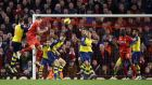 Liverpool's Martin Skrtel  heads home a late equaliser in the Premier League game against Arsenal at Anfield. Photograph:  Peter Byrne/PA