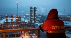 An employee looks out over the  petroleum cracking complex at the Lukoil-Nizhegorodnefteorgsintez oil refinery in Nizhny Novgorod, Russia. Crude slumped 18 percent last month as Opec maintained its output quot. Photograph: Andrey Rudakov/Bloomberg